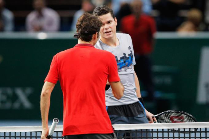 PARIS, FRANCE - OCTOBER 31:  Milos Raonic (R) of Canada shakes hands with Roger Federer of Switzerland after victory in their quarterfinal match during day 5 of the BNP Paribas Masters held at the at Palais Omnisports de Bercy on October 31, 2014 in Paris, France.  (Photo by Dean Mouhtaropoulos/Getty Images)